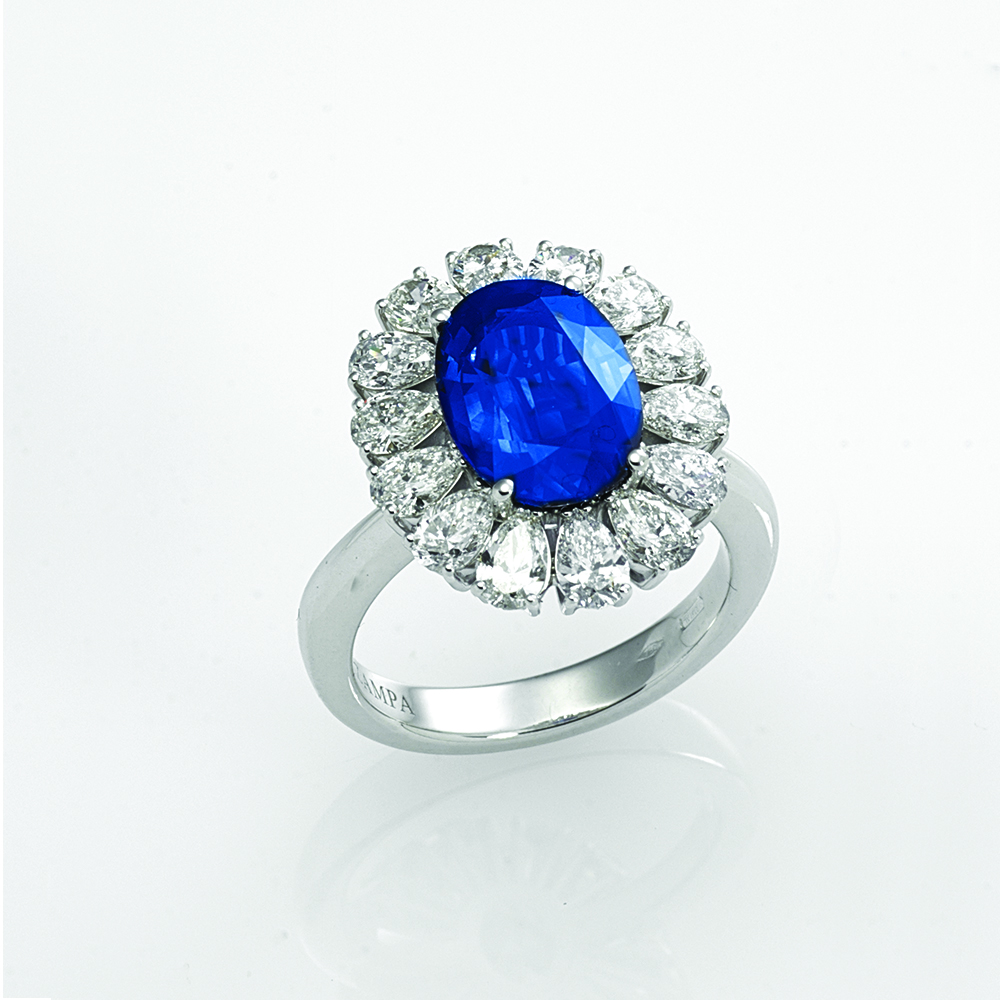 Ring, 18ct white gold with Pear Cut Natural Diamonds and Oval Cut Natural Blue Sapphire