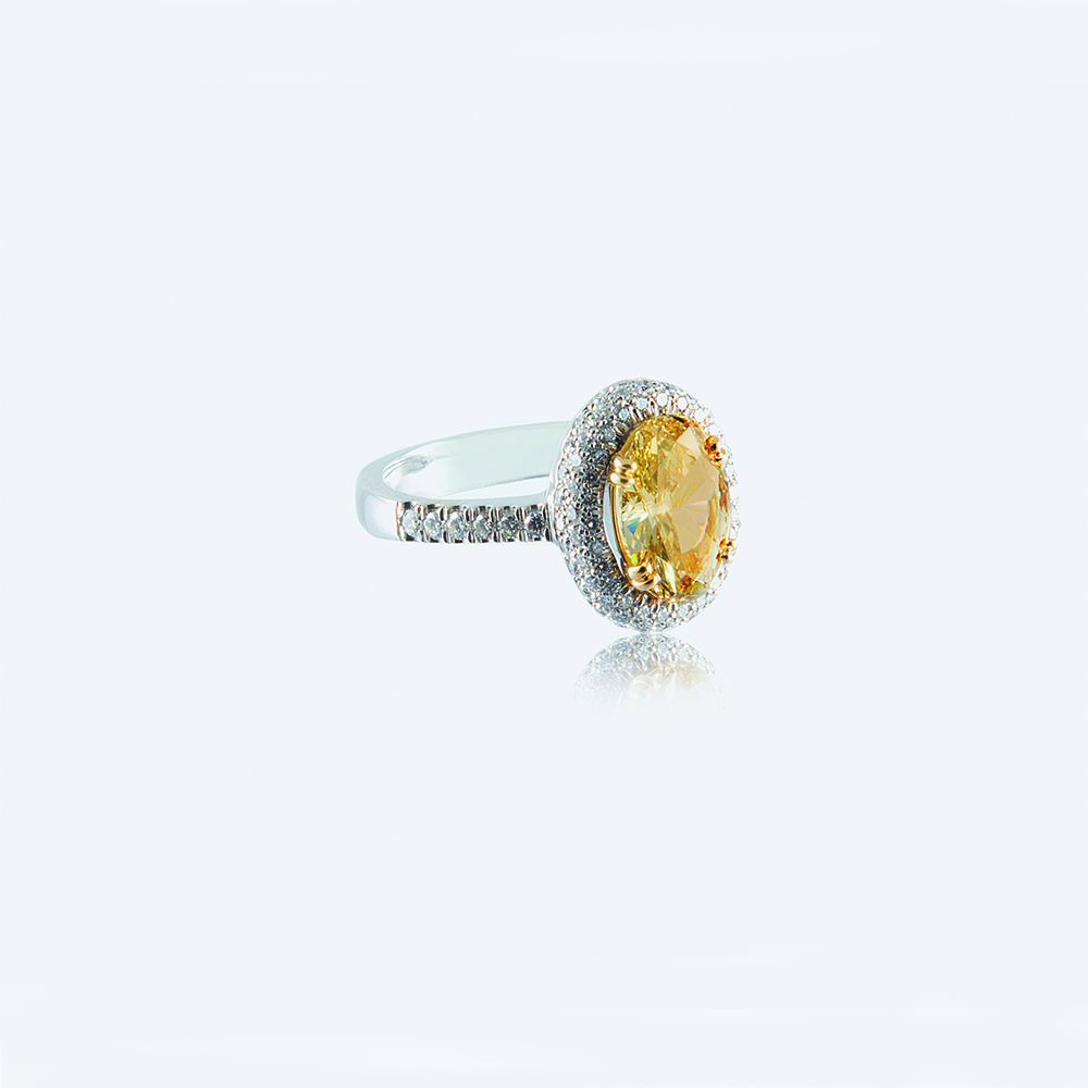 Ring, 18ct white gold with Oval Cut Fancy Yellow Diamond 2.27ct and Round Brilliant Cut Natural Diamonds - GIA Certified